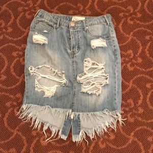 Denim skirt with rips